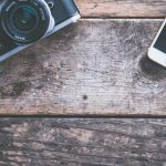 negative-space-vintage-camera-iphone-dslr-wood-table-jessica-lewis-thumb-1